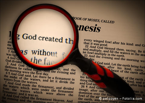 A focus, using a magnifying glass, on the words in Genesis 1:1