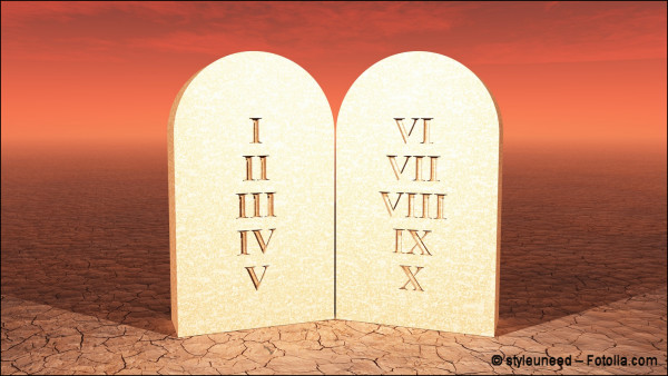 Tablets of the Ten Commandments (roman numerals only) on a stone floor