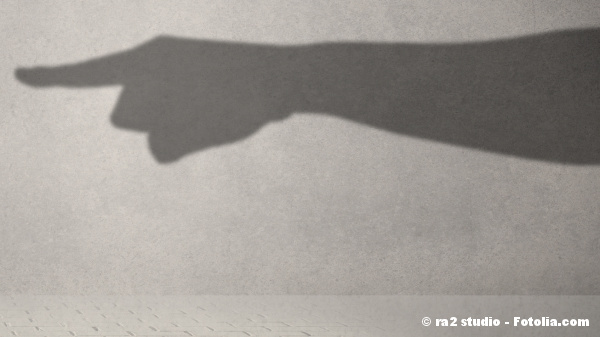 Huge pointing shadow hand