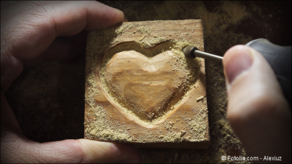 Carving wood in heart shape