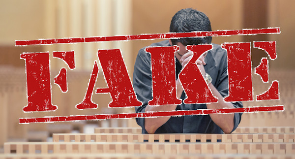 """The word """"fake"""" superimposed over a man praying by himself in a church building."""