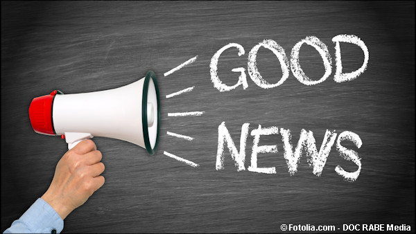 A megaphone announcing good news with a blackboard background