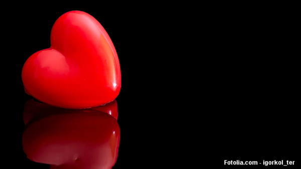 Red heart on a black reflective background
