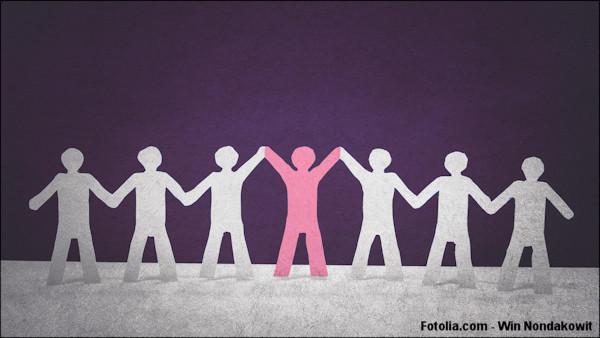 Paper cutouts depicting leadership in team