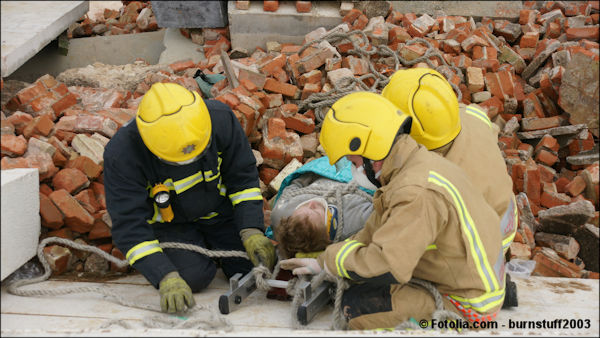 Rescue workers at a building collapse