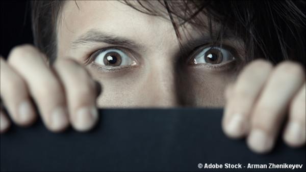 Closeup of man staring fearfully