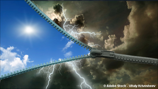 A zipper opening a stormy sky to reveal a bright blue sky