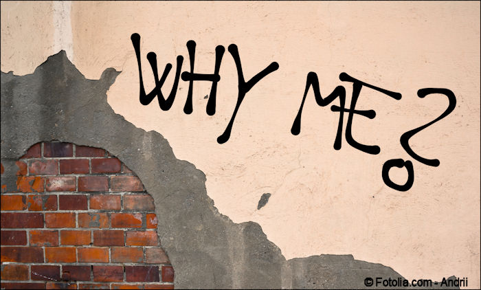 """""""Why Me?"""" handwritten on a plastered brick wall"""