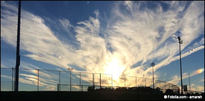 Angel-looking large cloud over baseball field