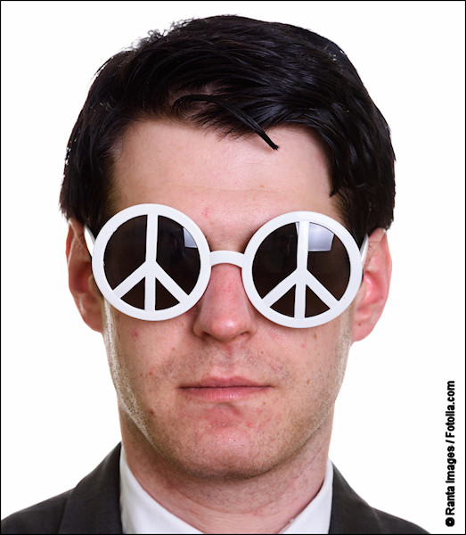 Face of a man wearing peace sign sunglasses