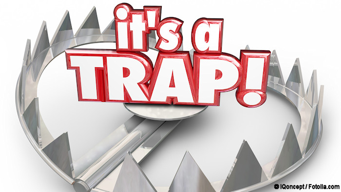 """The words """"It's a trap"""" in the center of a bear trap"""