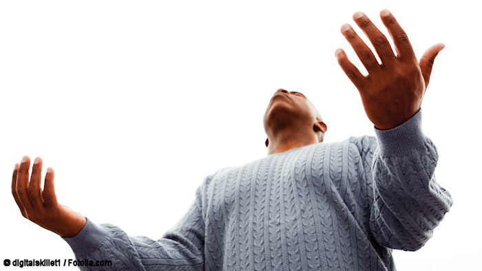 Man with open arms imploring God