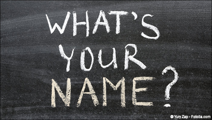 The words WHAT'S YOUR NAME? written on an chalk board
