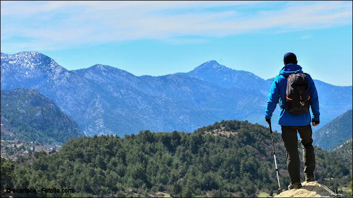 Man facing mountain range